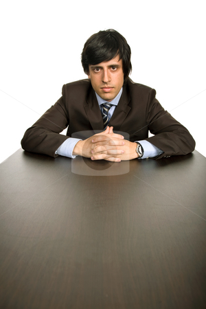 Worried stock photo, Young business man on a desk, isolated on white by Rui Vale de Sousa