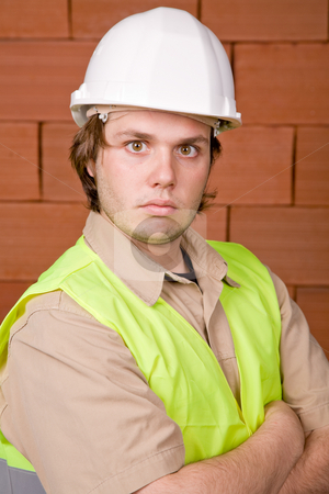 Foreman stock photo, Foreman with white hat with a brick wall as background by Rui Vale de Sousa