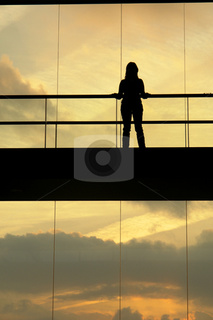 Woman stock photo, Woman in the modern buildind at sunset by Rui Vale de Sousa