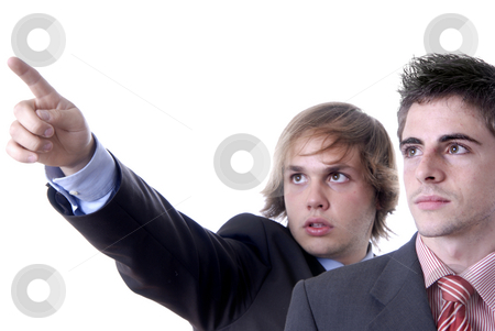 Pointing stock photo, Two young business men portrait on white. focus on the right man by Rui Vale de Sousa