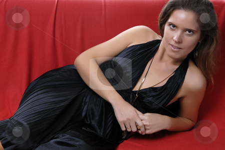 Woman stock photo, Portrait of a beautiful young woman in a sofa by Rui Vale de Sousa
