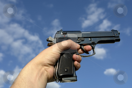 Gun stock photo, Pistol in hand and the sky as background by Rui Vale de Sousa