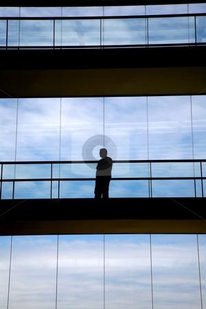 Shape stock photo, Worker inside the modern building in silhouette by Rui Vale de Sousa