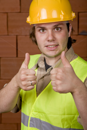 Foreman stock photo, Foreman with yellow hat and a brick wall as background by Rui Vale de Sousa