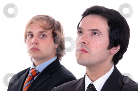 Serious stock photo, Two young business men portrait on white. focus on the man of the right by Rui Vale de Sousa