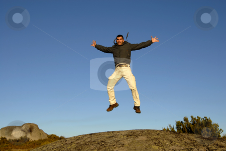 Jumps stock photo, Young man jumps high in the mountain by Rui Vale de Sousa