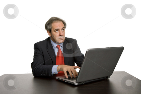 Pensive stock photo, Mature business man working with his laptop by Rui Vale de Sousa