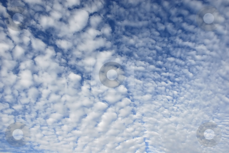 Clouds stock photo, White fluffy clouds in the blue sky by Rui Vale de Sousa