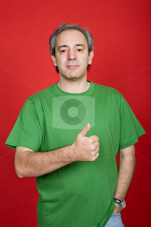 Thumb up stock photo, Mature casual man going thumb up, on a red background by Rui Vale de Sousa