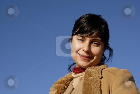Woman stock photo, Young woman close up portrait ans the blue sky by Rui Vale de Sousa