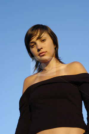 Look stock photo, Young woman posing against the blue sky by Rui Vale de Sousa