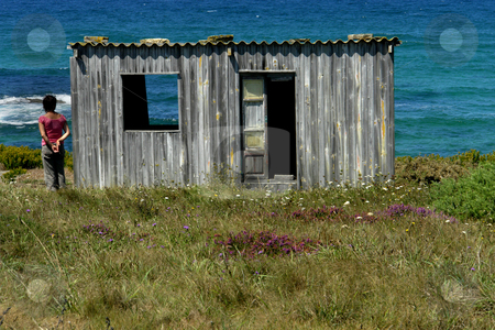 Wait stock photo, Woman and an old house at the coast by Rui Vale de Sousa