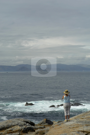 Woman stock photo, Woman taking a picture at the spanish coast by Rui Vale de Sousa
