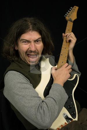 Rocker stock photo, Young rocker in studio picture, closeup portrait by Rui Vale de Sousa