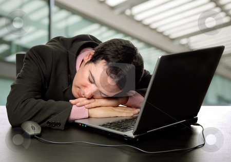 Sleep stock photo, Young business man sleeping on the laptop by Rui Vale de Sousa