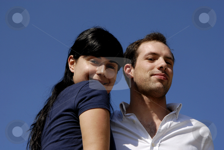 Love stock photo, Young couple with the sky as background by Rui Vale de Sousa