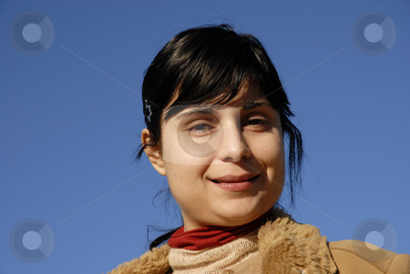 Portrait stock photo, Young woman close up portrait and the blue sky by Rui Vale de Sousa