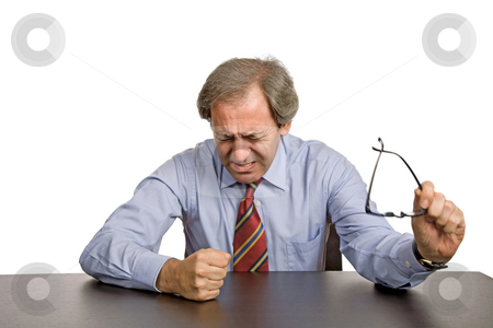 Worried stock photo, Worried business man on a desk, isolated on white by Rui Vale de Sousa