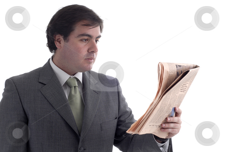 Reading stock photo, Young businessman with a newspaper isolated on white by Rui Vale de Sousa