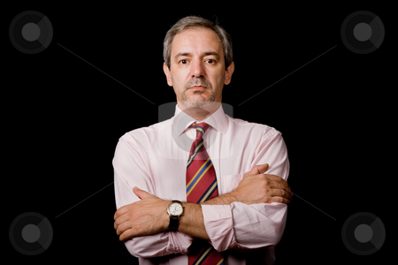 Serious stock photo, Mature business man portrait on black background by Rui Vale de Sousa