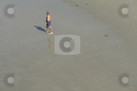Alone stock photo, Old man alone on the wet sand at the beach by Rui Vale de Sousa