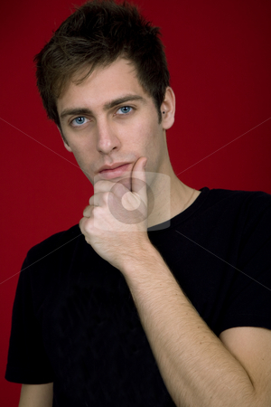 Pensive stock photo, Portrait of sexy young man, against red background by Rui Vale de Sousa