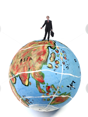 Globe stock photo, Young business man in the top of a globe by Rui Vale de Sousa
