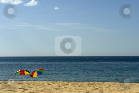 Umbrellas stock photo, Colorful beach umbrellas on the beach in the south of portugal by Rui Vale de Sousa