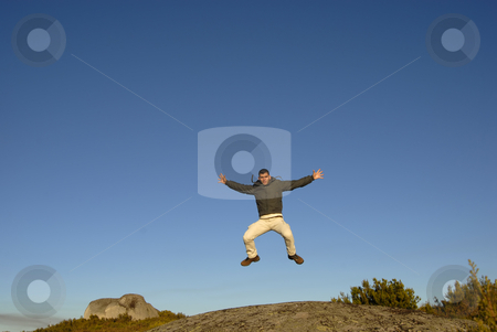 Jump stock photo, Young man jumps high in the mountain by Rui Vale de Sousa