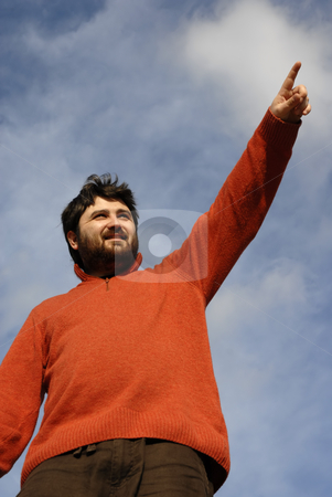 Pointing stock photo, Young man pointing and the sky as background by Rui Vale de Sousa