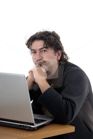 Working stock photo, An young man working with personal computer by Rui Vale de Sousa