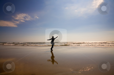 Freedom stock photo, Young woman running at the wet beach by Rui Vale de Sousa