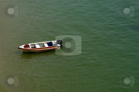 Boat stock photo, Small woden boat at the green ocean water by Rui Vale de Sousa