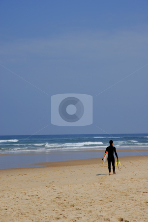Surfer stock photo, Young man surfer running at the beach by Rui Vale de Sousa