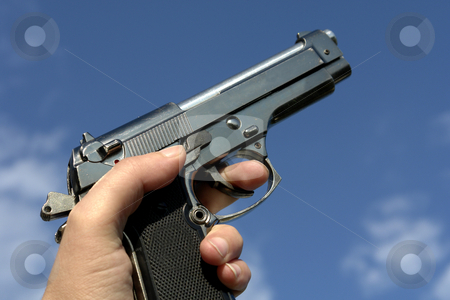 Gun stock photo, Gun in the hand by Rui Vale de Sousa