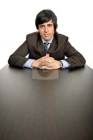 Worker stock photo, Young business man on a desk, isolated on white by Rui Vale de Sousa