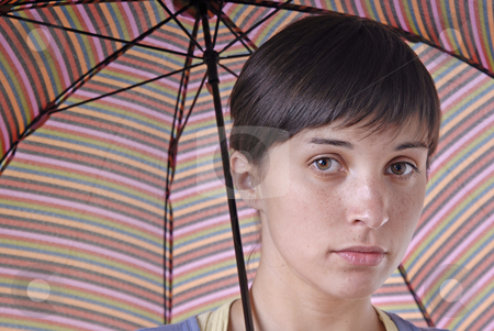 Girl stock photo, Young brunette girl with umbrella in colors by Rui Vale de Sousa