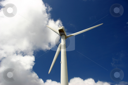 Alternative stock photo, Modern white wind turbine or wind mill producing energy to power a city by Rui Vale de Sousa
