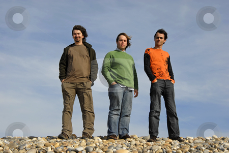 Three kids stock photo, Three casual young men at the beach by Rui Vale de Sousa