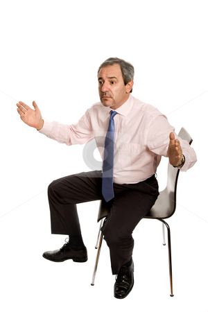 Seated stock photo, Mature businessman on a chair, isolated on white by Rui Vale de Sousa