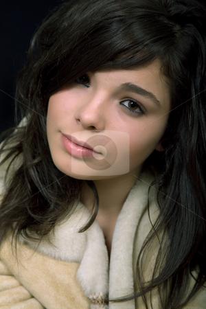 Closeup stock photo, Young beautiful brunette portrait against black background by Rui Vale de Sousa