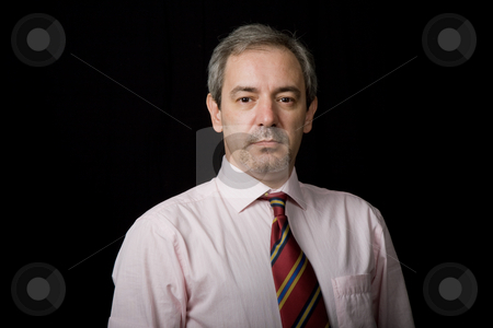 Looking stock photo, Mature business man portrait on black background by Rui Vale de Sousa