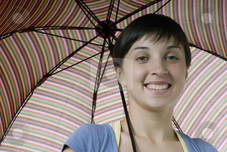 Umbrella stock photo, Young brunette girl with umbrella in colors by Rui Vale de Sousa
