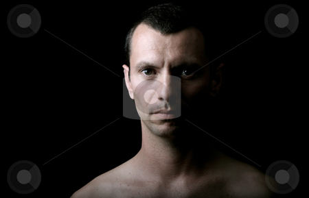Pensive stock photo, Young man model on a black background by Rui Vale de Sousa