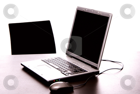 Work stock photo, Silver laptop with mouse on a office desk by Rui Vale de Sousa