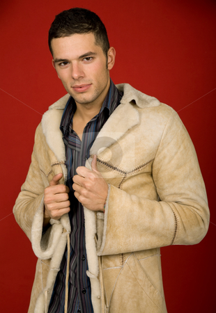 Fashion stock photo, Portrait of sexy young man, against red background by Rui Vale de Sousa