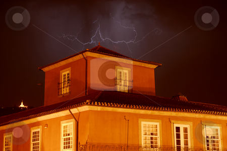 Lightning stock photo, Lightning over an old house in the night by Rui Vale de Sousa