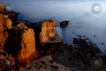 Sea over rocks stock photo, Long Exposure of sea over rocks - dreamy feel by Rui Vale de Sousa