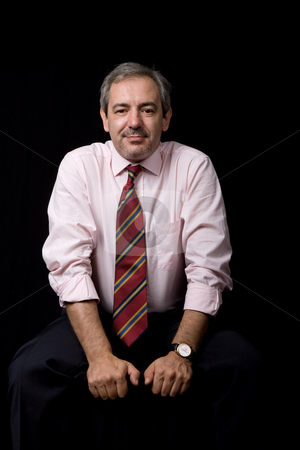 Mature stock photo, Mature business man portrait on black background by Rui Vale de Sousa