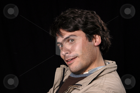 Silly stock photo, Crazy young man portrait isolated on black by Rui Vale de Sousa